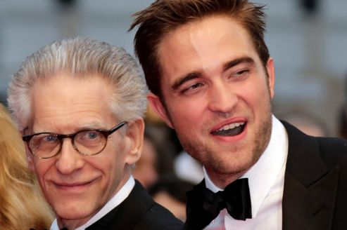 Cast member Pattinson and director Cronenberg pose on the red carpet ahead of the screening of the film Cosmopolis in competition at the 65th Cannes Film Festival